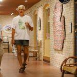 senior man walking the hallway